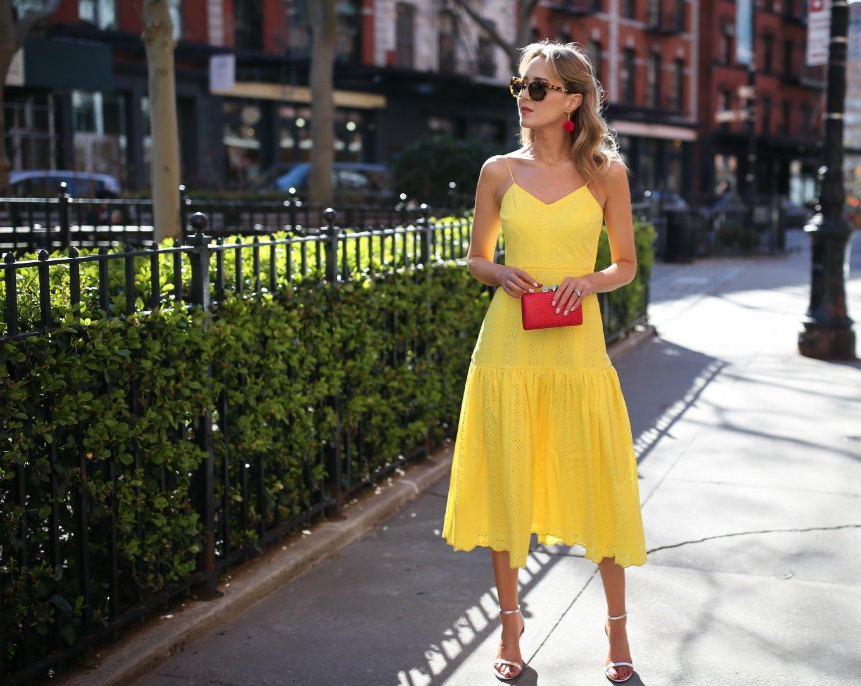 top-spring-fashion-trends-yellow-eyelet-j-crew-midi-dress-silver-metallic-heeled-sandals-red-clutch-tassel-earrings1
