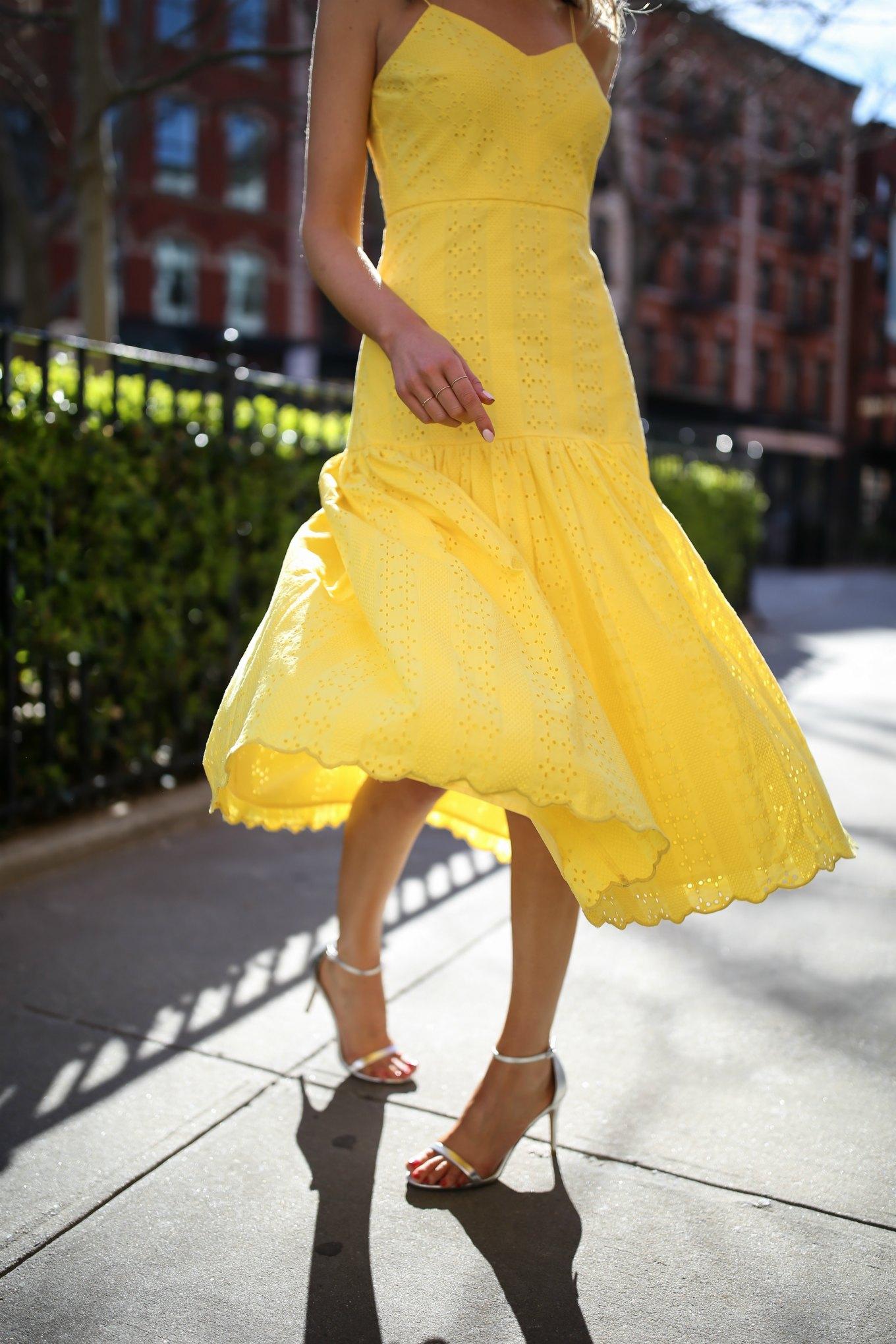 top-spring-fashion-trends-yellow-eyelet-j-crew-midi-dress-silver-metallic-heeled-sandals-red-clutch-tassel-earrings9