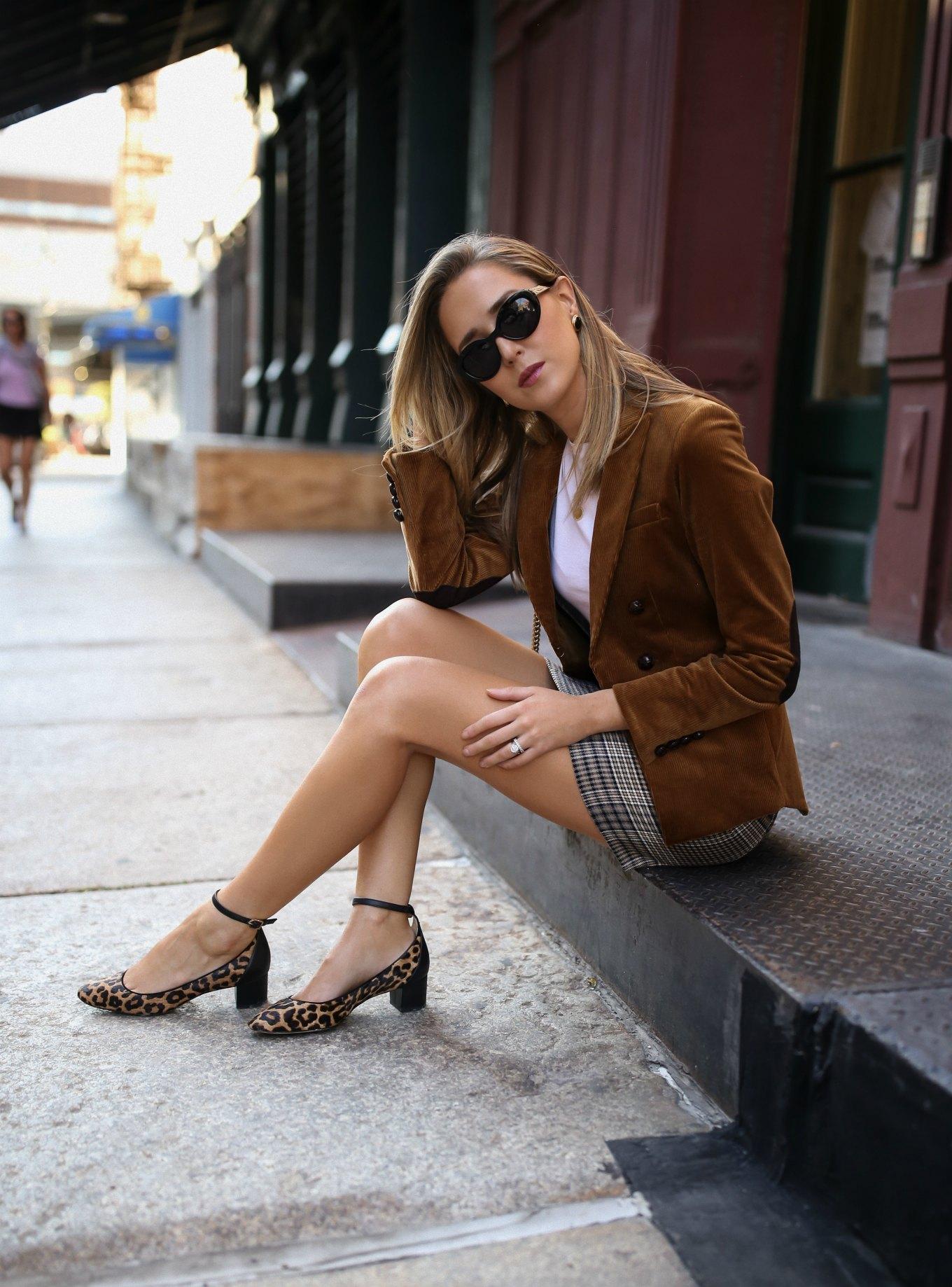 NYC fashion blogger Mary Orton of Memorandum wears a corduroy blazer, checked mini skirt, leopard print Sam Edelman ankle strap pumps and black cat eye sunglasses